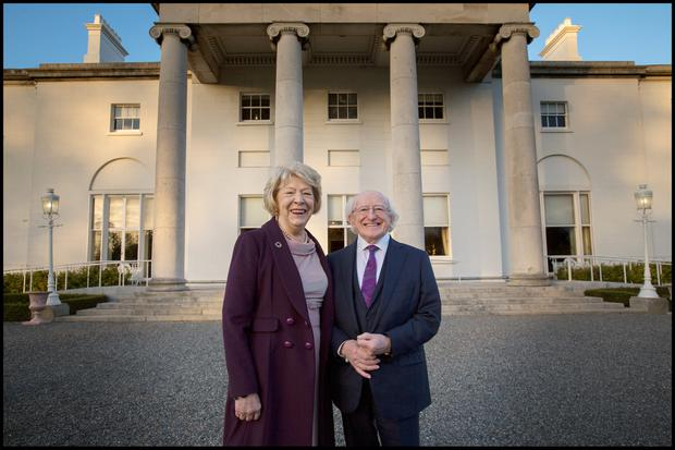 President Michael D Higgins and his wife Sabina outside Aras an Uachtarain yesterday. Photo: David Conachy