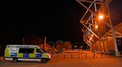 Emergency services outside the King Power Stadium in Leicester last night. Photo: PA