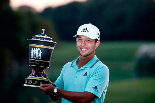 Xander Schauffele of the United States holds the trophy after winning the HSBC Champions golf tournament held at the Sheshan International Golf Club in Shanghai, Sunday, Oct. 28, 2018. (AP Photo/Ng Han Guan)
