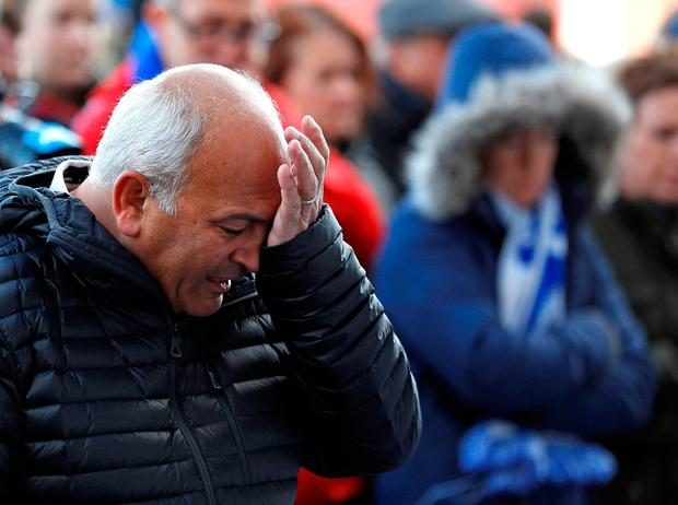 Leicester City football fans pay their respects outside the football stadium, after the helicopter of the club owner Thai businessman Vichai Srivaddhanaprabha crashed when leaving the ground on Saturday evening after the match, in Leicester, Britain, October 28, 2018. REUTERS/Peter Nicholls