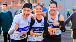 28/10/2018 Marathon runners running for Irish Liverpool fan Sean Cox (L to R) John o Malley, Sarah Meegan & Mark Mcdonald all from Dunboyne during the SSE Airtricity Dublin Marathon in Dublin's City Centre. Photo Gareth Chaney Collins