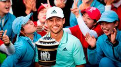 American Xander Schauffele poses with the trophy after winning the WGC-HSBC Champions in Shanghai. Photo: Johannes Eisele/AFP/Getty Images