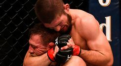 Khabib Nurmagomedov locks in a choke on Conor McGregor during their bout earlier this month. Photo: Stephen McCarthy/Sportsfile