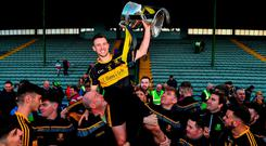 Dr Crokes captain John Payne is lifted shoulder high after collecting the Bishop Moynihan Cup following their Kerry SFC final victory over Dingle at Austin Stack Park. Photo: Brendan Moran/Sportsfile