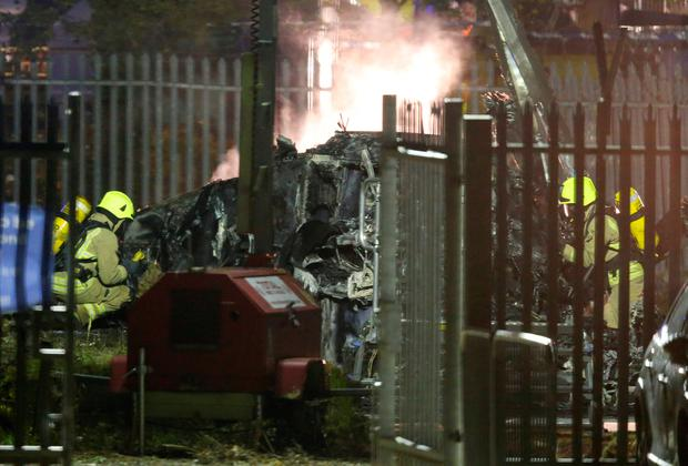 Aftermath: The burnt wreck of the helicopter in the car park yesterday. Photo: REUTERS/Andrew Yates
