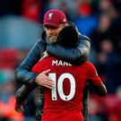 The main Mane: Jurgen Klopp embraces Sadio Mane after his two goals helped see off Cardiff. Photo: Reuters