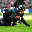 Jacksonville Jaguars quarterback Blake Bortles (5) is sacked by Philadelphia Eagles defensive end Chris Long (56). Photo: Steve Flynn-USA TODAY Sports