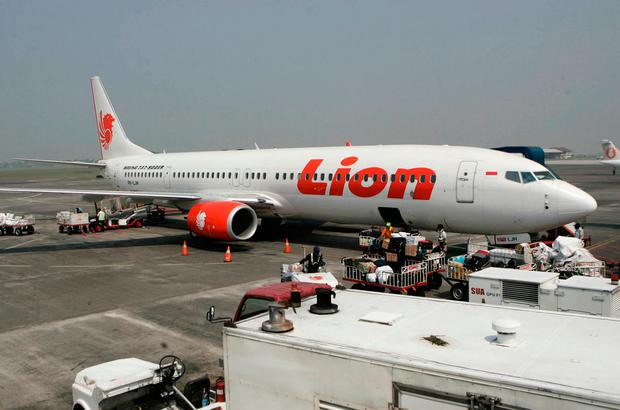 In this May 12, 2012 file photo, a Lion Air passenger jet is parked on the tarmac at Juanda International Airport in Surabaya, Indonesia. Indonesia's Lion Air said Monday, Oct. 29, 2018, it has lost contact with a passenger jet flying from Jakarta to an island off Sumatra. (AP Photo/Trisnadi, File)