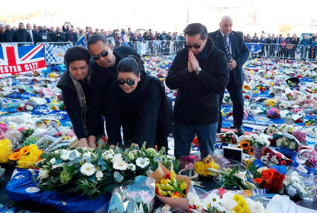 Khun Aiyawatt Srivaddhanaprabha and Aimon Srivaddhanaprabha, son and wife of Leicester City's owner Thai businessman Vichai Srivaddhanaprabha, lay a wreath for Vichai and four other people who died when the helicopter they were travelling in crashed as it left the ground after the match on Saturday, in Leicester, Britain, October 29, 2018. REUTERS/Peter Nicholls