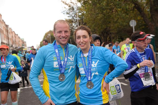 Shane Callaghan from Carlow proposes to Mag Kinsella in the finish area of the Dublin City Marathon. Pic: www.LiamMcArdle.com