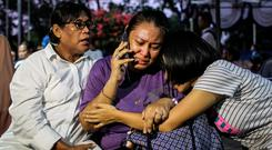 Distraught: Relatives of passengers on Lion Air flight JT610 wait at the airport in Jakarta. Photo: Reuters