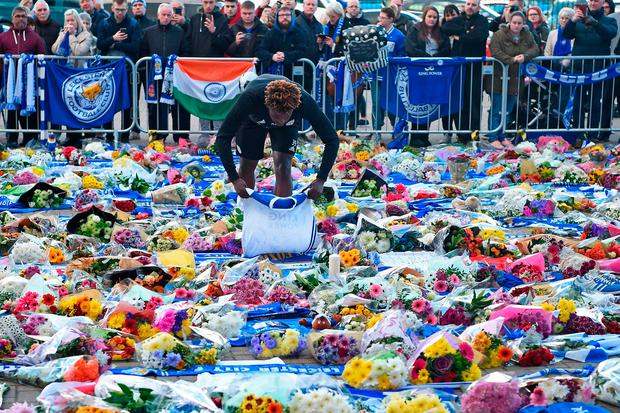 Memorial: Floral tributes continue to spread outside the King Power Stadium. Photo: Getty Images