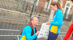 Engaging finish: Shane Callaghan, from Carlow, proposes to Marguerite Kinsella after the Dublin City Marathon. Photo: Liam McArdle