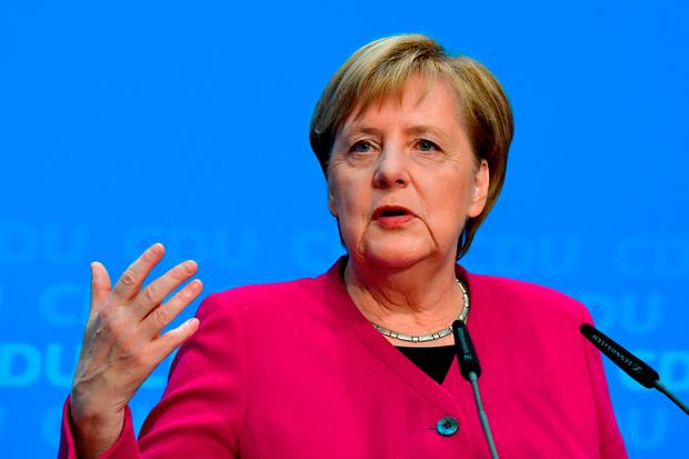 Going, going... : Angela Merkel yesterday announcing she will stand down from the CDU party. Photo: AFP/Getty Images