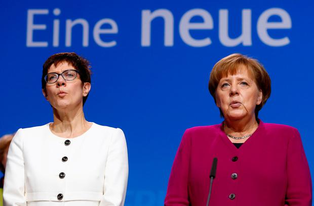 German Chancellor Angela Merkel and Annegret Kramp-Karrenbauer. Photo: REUTERS/Fabrizio Bensch/File Photo