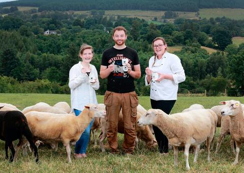 Farmer George Finlay pictured with finacee Hannah Sheerin (far left) and sister and chef Amanda Finlay with some of the East Friesland sheep on the family farm near the Glen of Imaal in Co Wicklow. Photo: Frank McGrath