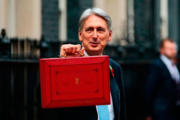 Chancellor of the Exchequer, Philip Hammond, presents the red Budget Box as he departs 11 Downing Street to deliver his 2018 budget announcement to Parliament. Photo: Jack Taylor/Getty Images