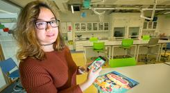 Camera ready: Augmented reality team member Jazheel Luna at the launch of the 'Science Apprentice' series of books. Photo: Tony Gavin