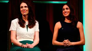 Meghan, Britain's Duchess of Sussex (R) attends a reception hosted by New Zealand's Prime Minister Jacinda Ardern at the Auckland War Memorial Museum in Auckland on October 30, 2018