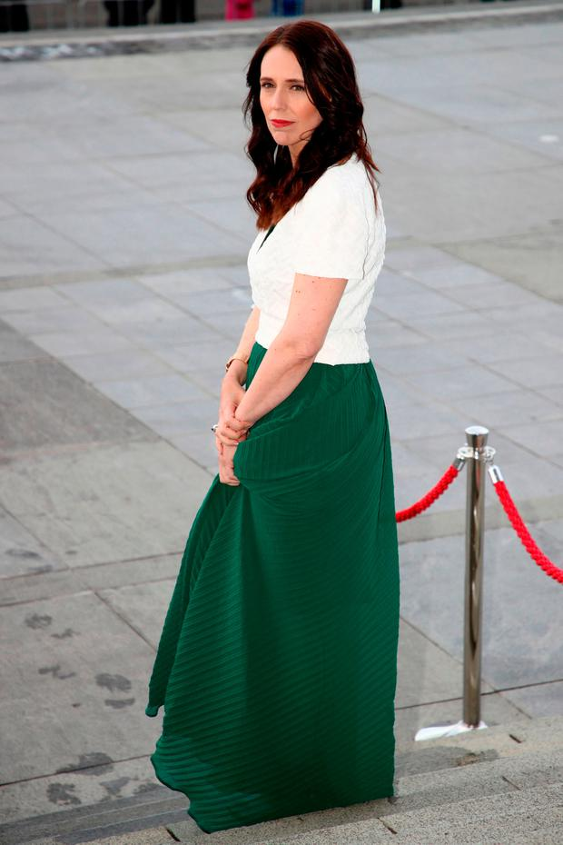 New Zealand's Prime Minister Jacinda Ardern waits for the arrival of Britain's Prince Harry and his wife Meghan, Duchess of Sussex at a reception at the Auckland War Memorial Museum in Auckland on October 30, 2018
