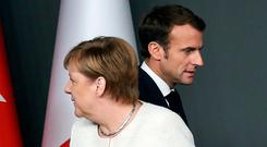 'The one to watch from here on is President Macron as Merkel's exit puts him centre stage.' Photo: REUTERS