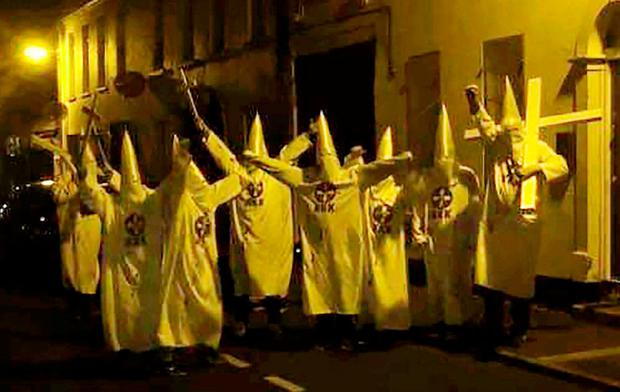 Condemned: The group in KKK garb outside the mosque in Newtownards