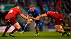 6 October 2018; Dan Leavy of Leinster is tackled by Niall Scannell, left, and Sammy Arnold of Munster during the Guinness PRO14 Round 6 match between Leinster and Munster at the Aviva Stadium in Dublin. Photo by Ramsey Cardy/Sportsfile