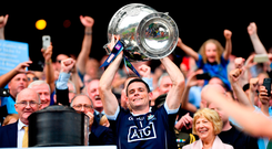 Dublin captain Stephen Cluxton lifts the Sam Maguire Cup last September. Photo by Stephen McCarthy/Sportsfile
