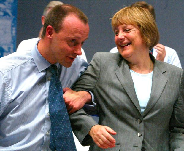 Friedrich Merz and Angela Merkel in 2002. Photo: Reuters