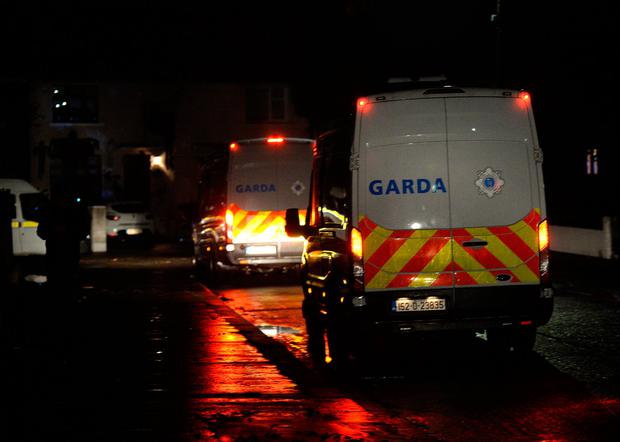 General view of Garda Public Order unit vehicles on Benbulbin road, Drimnagh, Dublin, on Halloween evening. Picture: Caroline Quinn