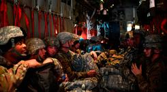 Waiting game: Soldiers from the 541st Sapper Company wait for take-off from Arkansas to the border. Photo: Getty Images