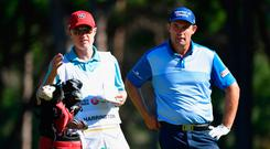 Caddy Ronan Flood and Pádraig Harrington ponder their next move during the opening round of the Turkish Airlines Open. Photo: Stuart Franklin/Getty Images