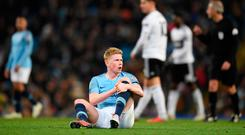 MANCHESTER, ENGLAND - NOVEMBER 01: Kevin De Bruyne of Manchester City goes down injured during the Carabao Cup Fourth Round match between Manchester City and Fulham at Etihad Stadium on November 1, 2018 in Manchester, England. (Photo by Michael Regan/Getty Images)