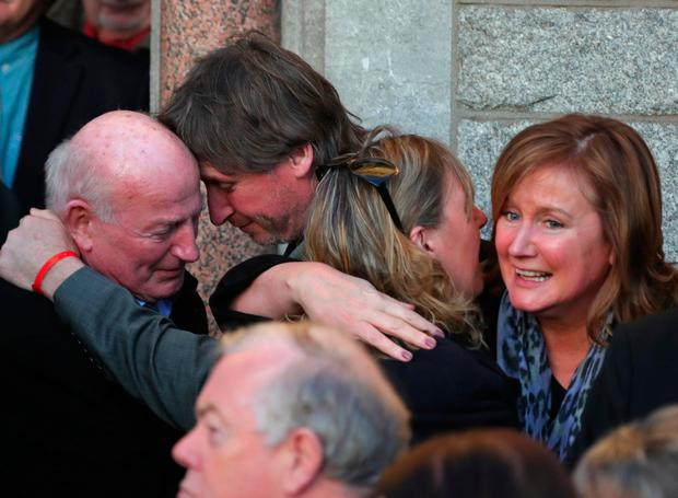 Family members are consoled. Picture: Colin Keegan