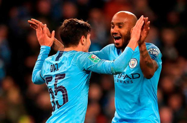 Manchester City's Brahim Diaz (left) celebrates scoring his side's second goal of the game with Fabian Delph. Photo: Mike Egerton/PA Wire