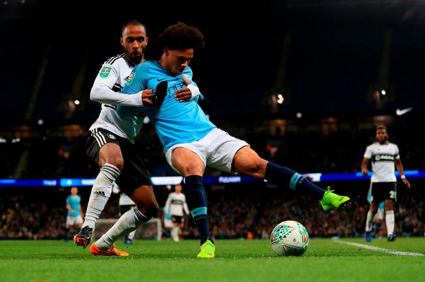 Fulham's Dennis Odoi and Manchester City's Leroy Sane (right) battle for the ball. Photo: Mike Egerton/PA Wire