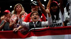 Fanbase: Members of the crowd at the Trump rally in Florida on Wednesday. Photo: REUTERS/Carlos Barria