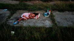 A child sleeps as members of the Central American caravan settle in for the night in a abandoned motel on November 01, 2018 in Matias Romero Avendando, Mexico. Photo by Spencer Platt/Getty Images