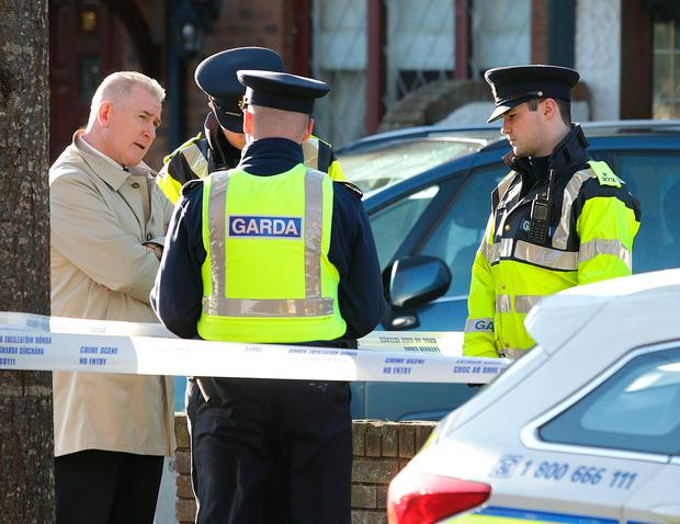 2/11/2018, Pat Leahy, left, assistant commissioner speaks to Garda at the scene of a house in Tudor Lawns, Foxrock where the body of a man in his 20's has been discovered. Pic credit; Damien Eagers / INM
