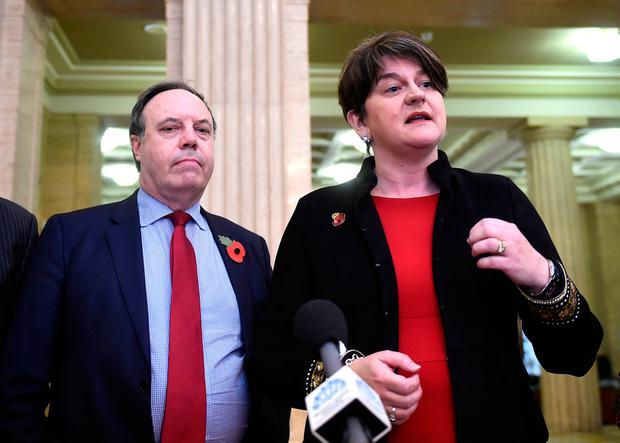 DUP Leader Arlene Foster and Deputy Leader Nigel Dodds talk to the media at a news conference at Stormont in Belfast, Northern Ireland