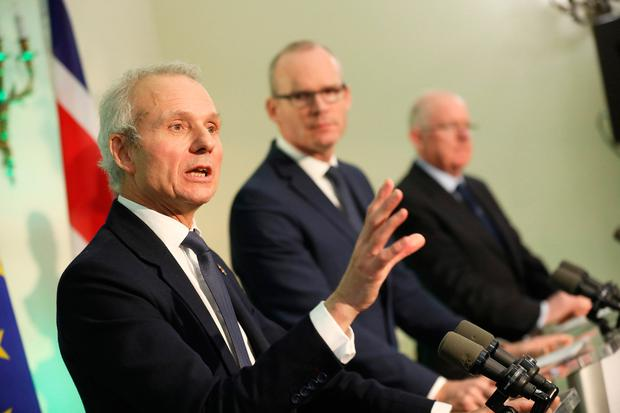Handout photos issued by Julien Behal of a meeting of (left to right) David Lidington, Simon Coveney and Charles Flanagan speaking during the British-Irish Intergovernmental Conference. Photo: Julien Behal/PA Wire