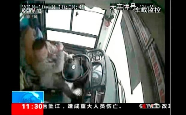 Surveillance video footage shows the bus driver defence himself moments before the bus plunged off a bridge