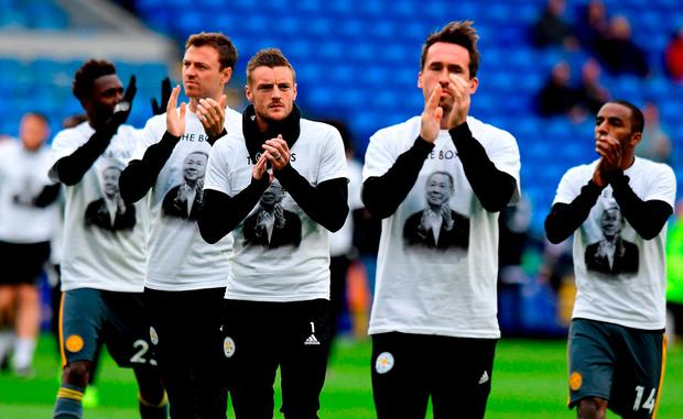 Leicester City's Jamie Vardy (centre) wears a Vichai Srivaddhanaprabha shirt during warm-up the Premier League match at the Cardiff City Stadium