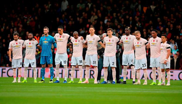 Manchester United players observe a minutes silence for Armistice Day and also the victims of the Leicester helicopter crash, which included Leicester Chairman, Vichai Srivaddhanaprabha the Premier League match at The Vitality Stadium, Bournemouth.