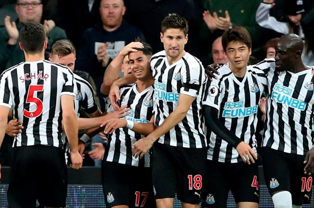 Newcastle United's Ayoze Perez celebrates scoring their first goal with teammates. REUTERS/Scott Heppell