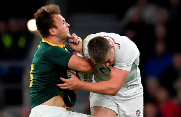 England's Owen Farrell makes a challenge on South Africa's Andre Esterhuizen REUTERS  Toby Melville