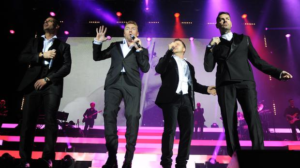 Keith Duffy, Ronan Keating, Mikey Graham and Shane Lynch of Boyzone perform for the Boyzone 20th anniversary tour in Cardiff on December 1, 2013.