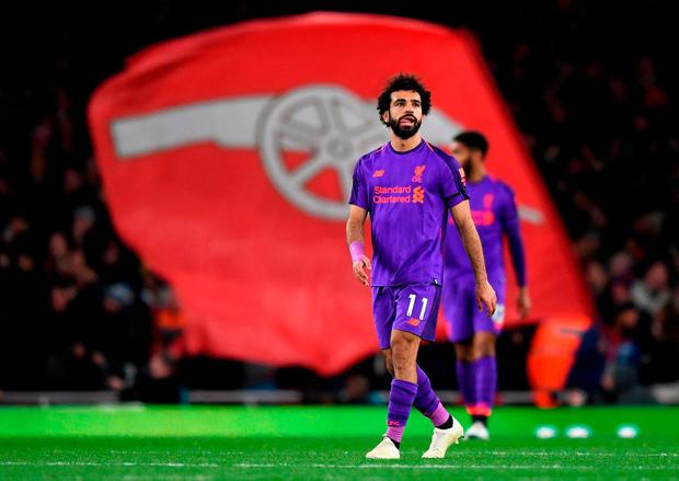 Mohamed Salah of Liverpool looks on after Alexandre Lacazette of Arsenal (not pictured) scores his sides equaliser