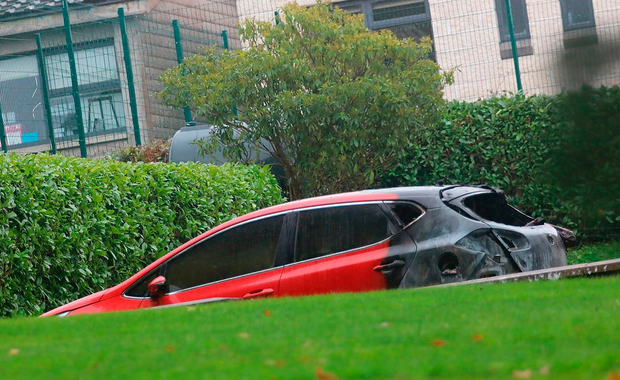 The burnt-out car belonging to the daughter of Tony Lunney, a senior manager at QIH