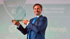 Tim Murtagh with his Men's International Player of the Year award at the Cricket Ireland awards on Friday night. Photo: Sportsfile